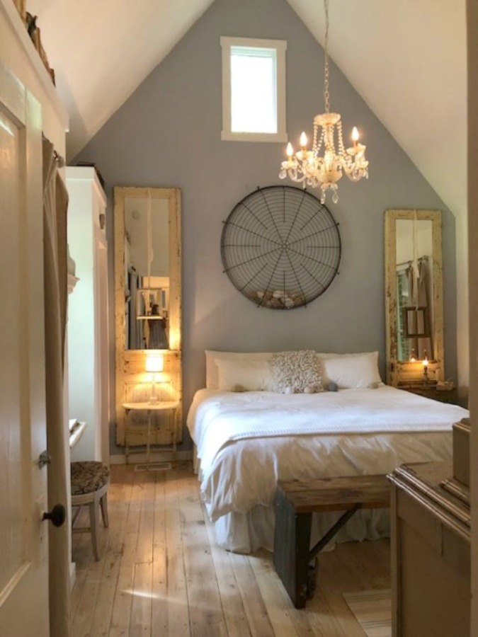 Serene and peaceful, this cottage bedroom with farmhouse style and vintage furniture at Storybook Cottage (Leiper's Fork, TN) was designed by Kim Leggett of City Farmhouse. #farmhousestyle #storybookcottage #cityfarmhouse #bedroom #farmhousebedroom