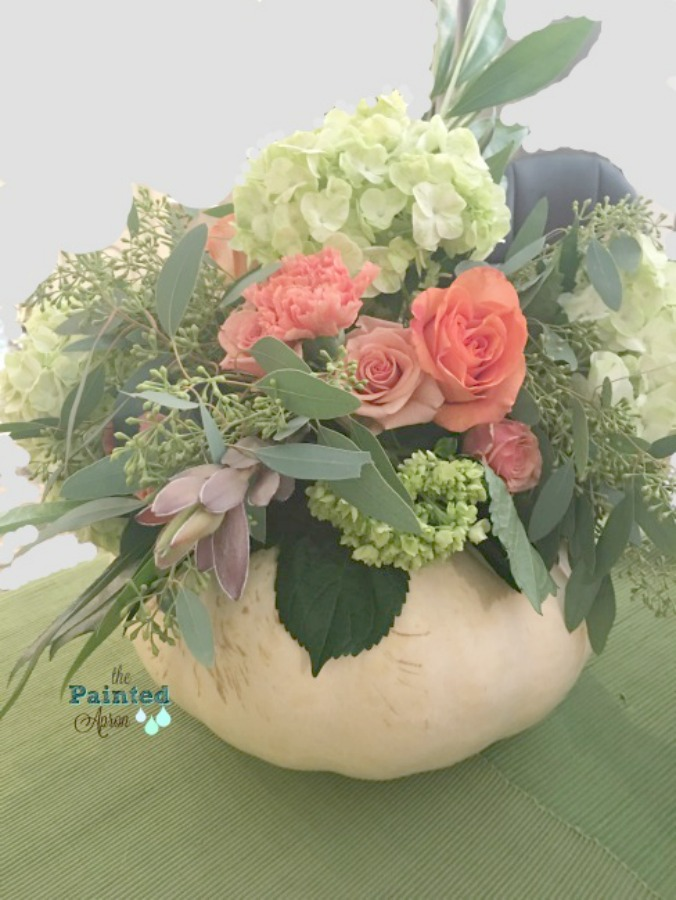 Fall tablescape centerpiece! A white pumpkin filled with fresh flowers - a creation by The Painted Apron.