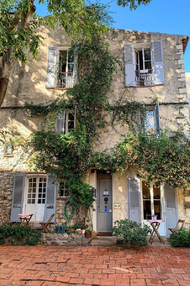 French country home exterior with blue shutters and stone - blissful fall inspo from Antibes! #frenchcountry #houseexteriors #houseinfrance
