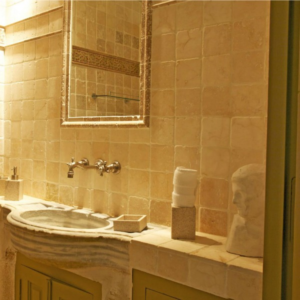 Tumbled stone in an 18th century French bastide bathroom. A breathtaking French bastide in Bonnieux in the South of France - a luxurious vacation home by Haven In. #frenchcountry #southoffrance #luxuryhome #frenchvilla