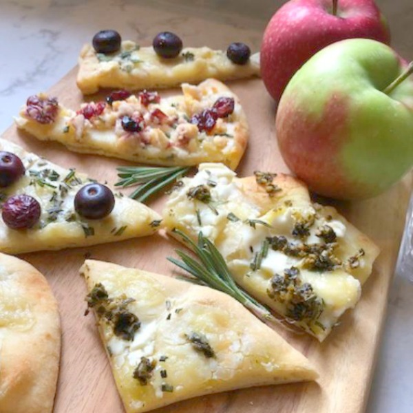 Hello Lovely's 10 minute cheesy easy festive appetizer comes together quickly with store-bought flatbread! Perfect for holiday entertaining and Thanksgiving. #appetizer #easyrecipes #flatbread #briecheese