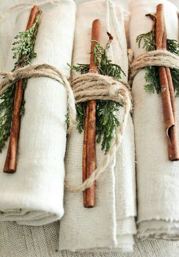 Holiday decor inspiration for the table with these rustic natural organic linen napkins wrapped simply in twine and greenery. #simplechristmas #holidaydecor #napkins #tablescape