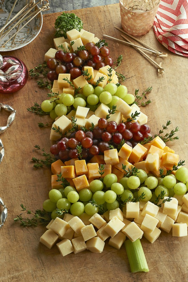 Whimsical presentation of cheese and fruit for Christmas party entertaining! Ciao Newport Beach. #christmastree #appetizer #cheeseboard #entertaining #appetizers