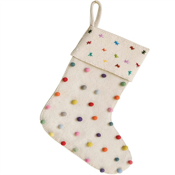 Pom Pom Christmas stocking is a colorful and whimsical holiday nod to make your mantelscape cheerier. #holidaydecor #christmas #stocking #pompoms