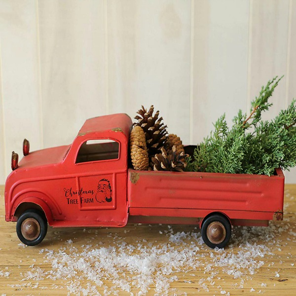 Whimsical vintage style red tin pickup truck with Christmas tree. #holidaydecor #christmasdecorating #pickuptruck #vintagestyle