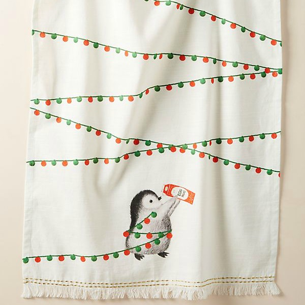 Whimsical penguin dishtowel for your holiday kitchen is a smile for you or the perfect gift. #holidaydecorating #penguin #dishtowel