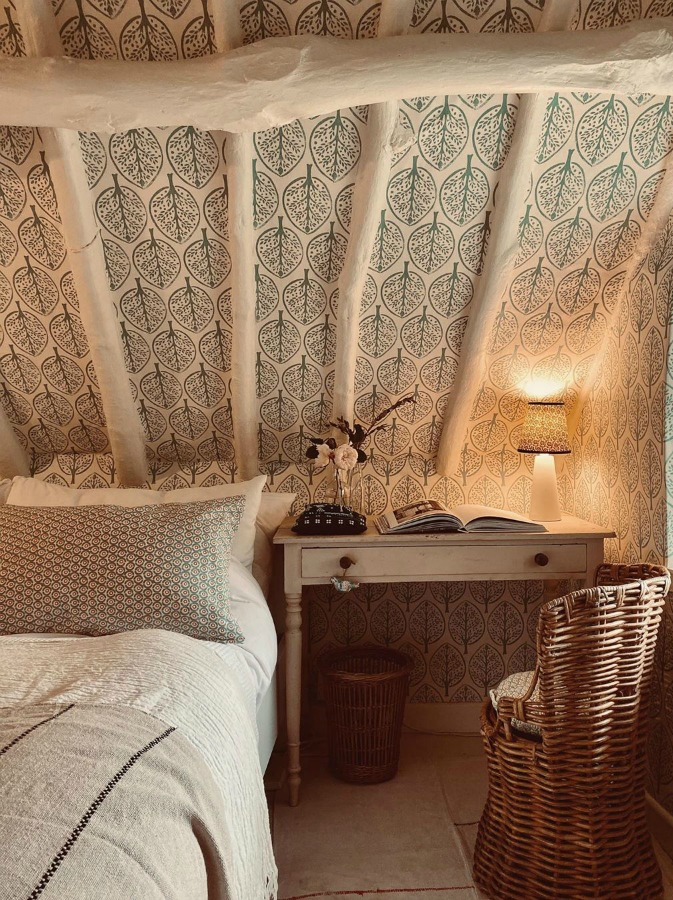 Charming Cotswolds cottage rustic bedroom with leaf wallpaper and vintage charm - design by Faeger and Co. #cotswolds #cottagebedroom #interiordesign #wallpaper #rusticdecor
