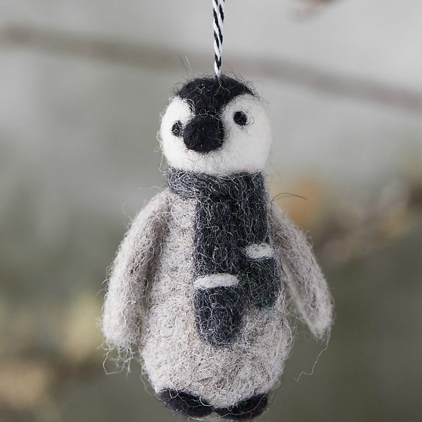 Felted wool penguin looks darling on the tree or from a door knob during the holidays and all winter through. #penguin #feltedwool #ornaments #christmasdecor