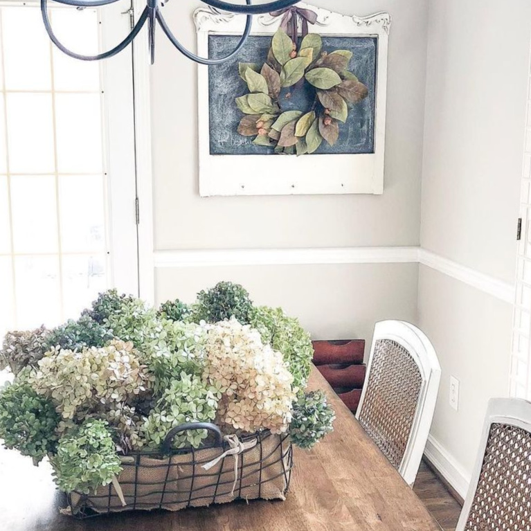 French country fall dried hydrangea on a dining room table creates a serene tranquil look - Adams and Elm Home. #frenchfall  #frenchcountry #falldecor #driedhydrangea #centerpieces