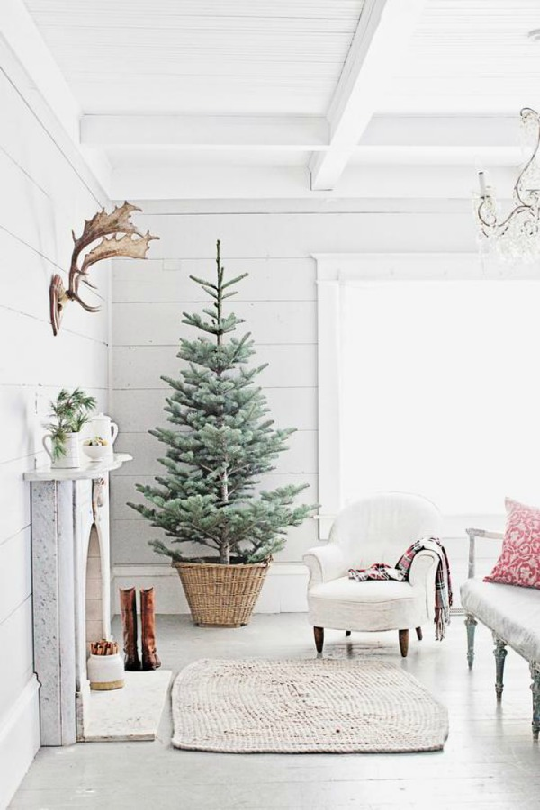 French farmhouse Christmas with fireplace, tree, and rustic vintage charm from Dreamy Whites. #frenchfarmhouse #christmasdecor #whitedecor #whitechristmas #farmhousechristmas