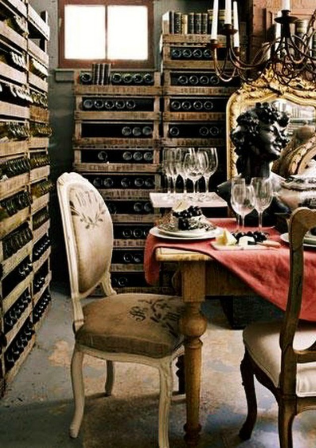A charming French country dining vignette in a wine cellar with design by EurotrashAnnie. #winecellar #frenchcountry #louischair #interiordesign