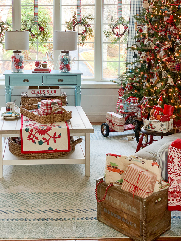 Darling and whimsical Christmas decor in a cheerful cottage living room with pinks and aquas - Goldenboysandme. #whimsicalchristmas #christmasdecor #livingroom #cottagestyle #farmhousechristmas