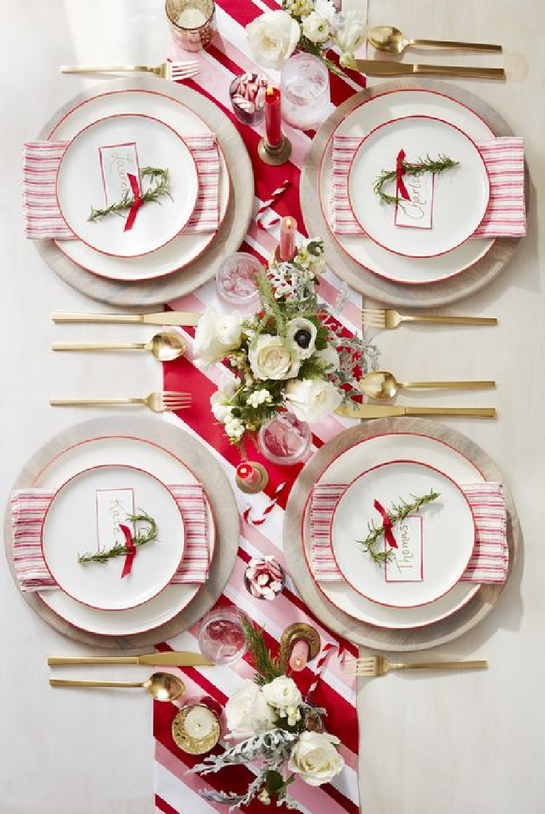 Cheerful and cozy red peppermint pinstripe theme tablescape for Christmas and holidays.