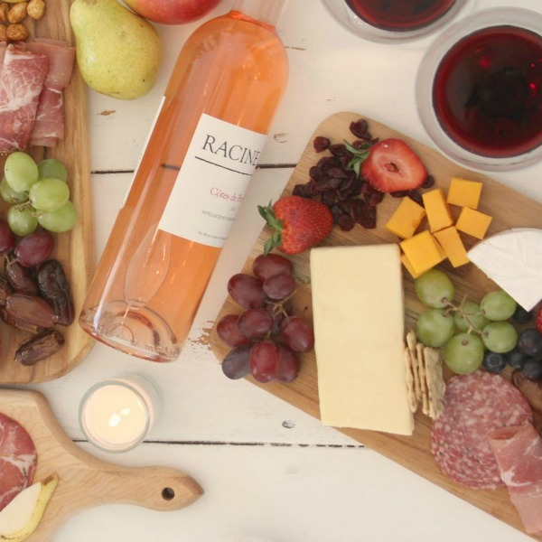 Vibrant colors for these easy to assemble graze boards (cheese boards!) with fruit, nuts, and wine - Hello Lovely Studio. #grazeboard #howto #cheeseboard #entertaining #cheese