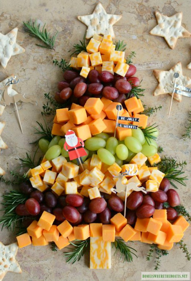 Creative and whimsical Christmas tree cheese board for a holiday party and easy entertaining. Home is Where the Boat Is. #cheeseboard #christmastree #holidayparty #appetizers