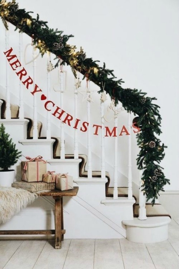 Simple Christmas banner and greenery on staircase - a lovely fresh country welcome! #christmasdecor #staircase #greenery #holidaydecorating