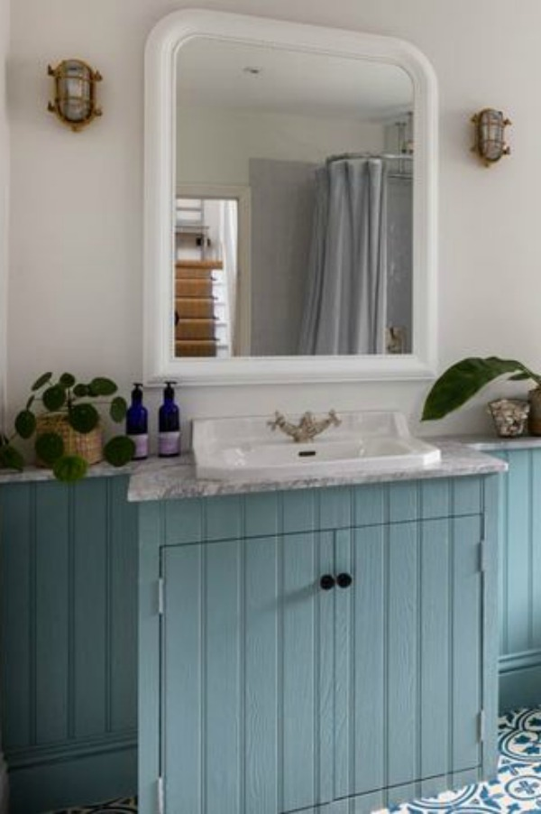 Teal blue painted bathroom vanity in a lovely design by Imperfect Interiors in the UK.PLEASE COME SEE Traditional Style Bathroom Vanity Design Inspiration as well as Vintage Bath Ideas. #bathroomdesign #bathroomvanities #interiordesign