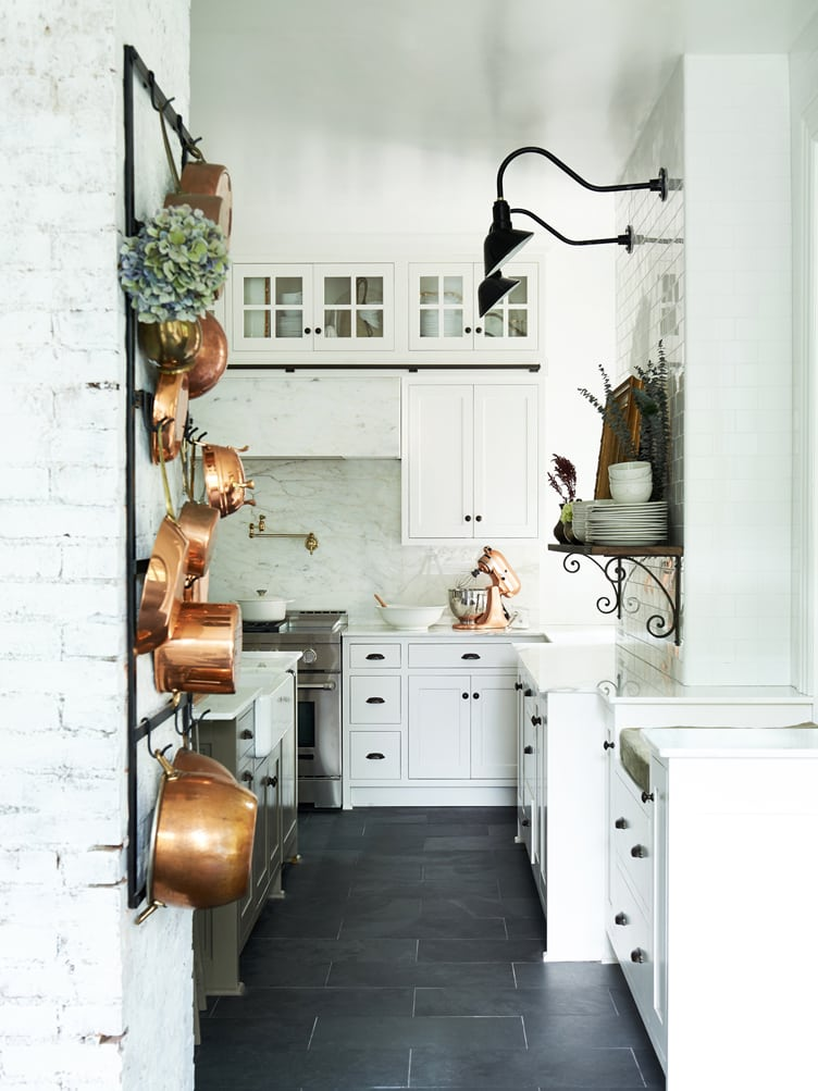 Leanne Ford designed kitchen with black and white and copper! #leanneford #kitchendesign #farmhousekitchen #blackandwhite