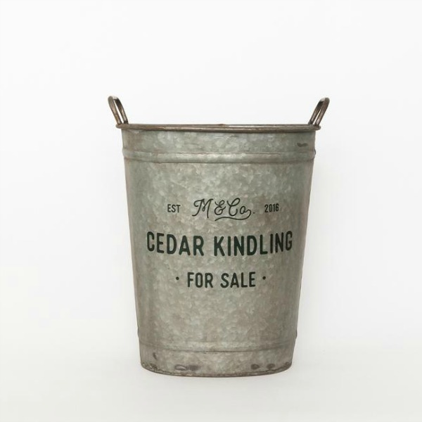 Evergreen bucket is perfect for a farmhouse style Christmas or rustic holiday decorating! #bucket #galvanized #farmhousechristmas #holidaydecor