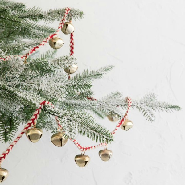 Sleigh bell garland for the Christmas tree adds nostalgia and sweetness to the holiday decorating. #sleighbells #holidaydecor #christmastree #garland