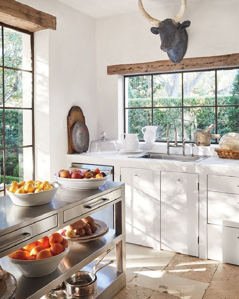French country white kitchen designed by Pamela Pierce - photo by Miguel Flores Vianna. #frenchkitchen #frenchcountry #kitchendesign #oldworld #pamelapierce #modernfrench
