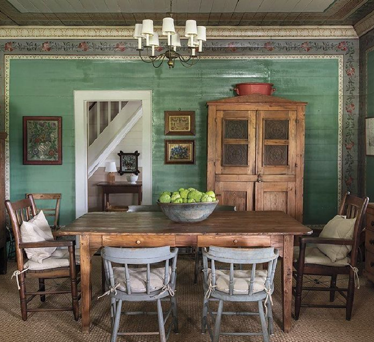 Rustic farmhouse dining room with original 19th century turquoise painted wall and floral stenciling. Design by Beverly Jacomini in Milieu magazine (photography @vitalephoto). #rusticfarmhouse #diningroom #beverlyjacomini