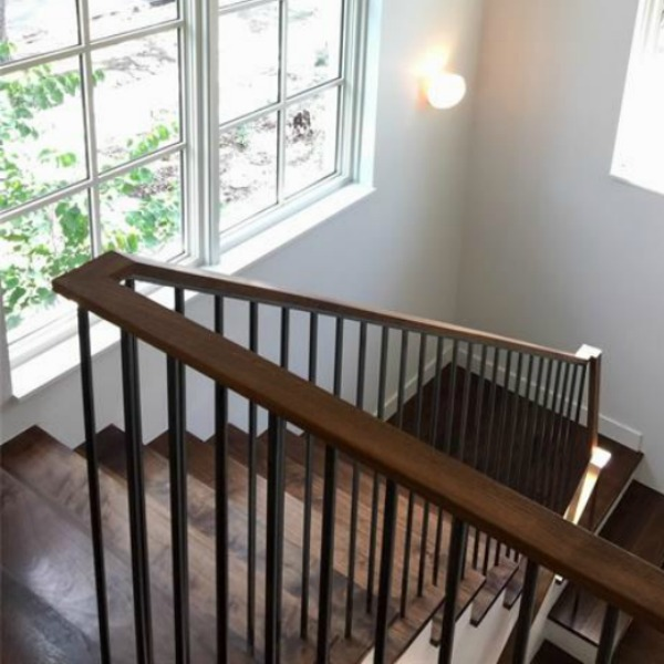Modern Belgian style interior design shines in the architecture, interior design, and construction of a wood staircase - Southampton Homes.