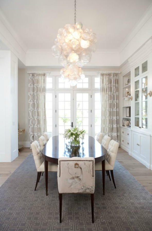 Dining room with white built-ins and soaring ceilings in a home with modern French interior design in Queen Creek, AZ. #modernfrench #diningroom