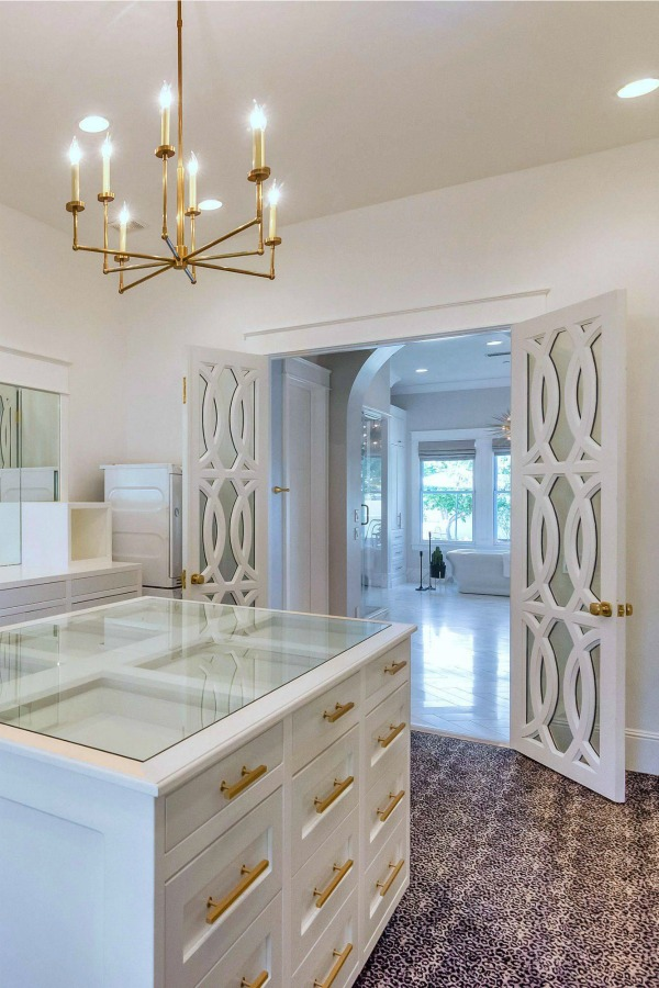 Luxurious and spacious dressing room closet in a modern French home. #closetdesign #dressingroom #modernfrench #luxuriousdesign