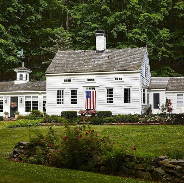 Beautiful exterior of a white cottage in Connecticut with interior design by Nora Murphy. #whitecottage #houseexterior #newengland #Connecticuthouse #beautifulhouse #architecture #historiccottage #noramurphy