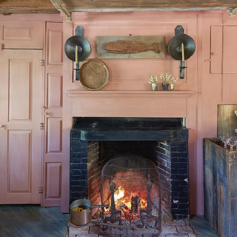 Salmon pink panels and rustic fireplace in Dudley Pike Tavern - featured in Nora Murphy's Country House book.