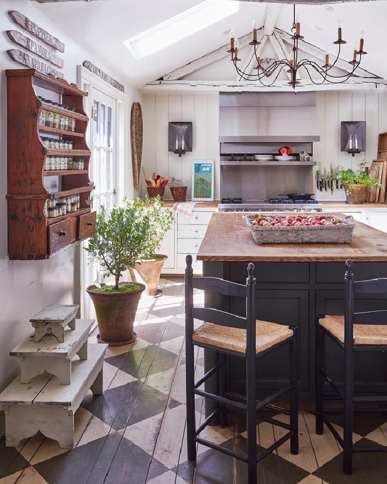 Nora Murphy's charming country kitchen in her Connecticut farmhouse with checkered floors and primitives. #noramurphy #countrykitchen #checkeredfloor