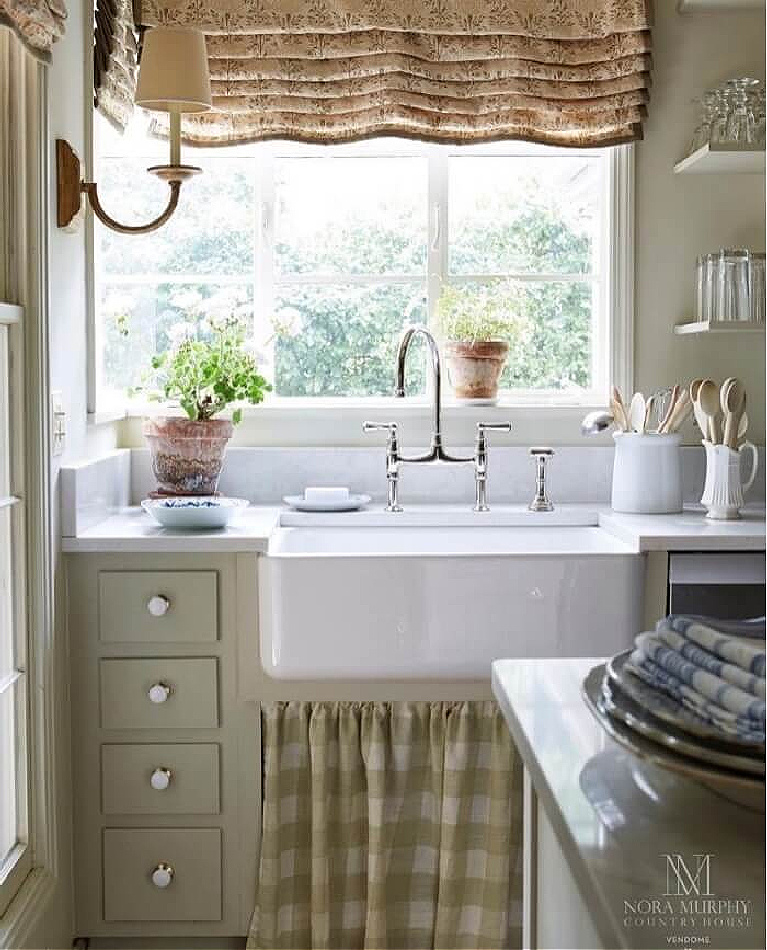 Beautiful country kitchen with farm sink in Nora Murphy's Country House book.