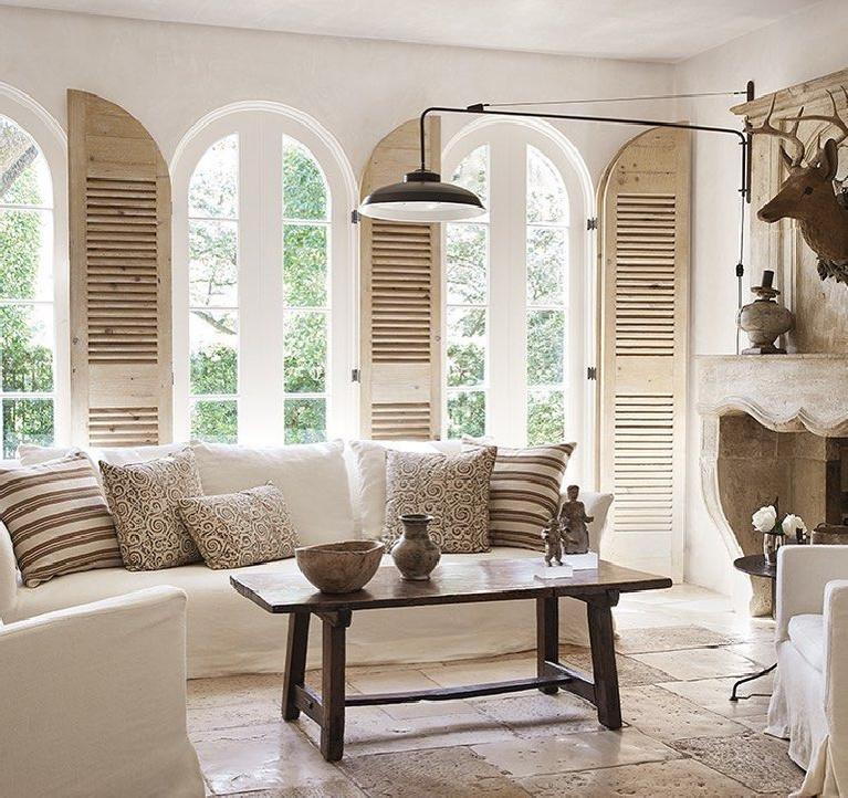 Modern French and minimal white living room with rustic shutters and all white interior design by Pamela Pierce. #pamelapierce #livingroom #modernfrench #allwhitedecor #frenchcountry