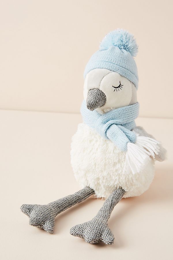 Stuffed penguin with winter pom pom hat adds sweetness to your holiday decor. #penguin #christmasdecor