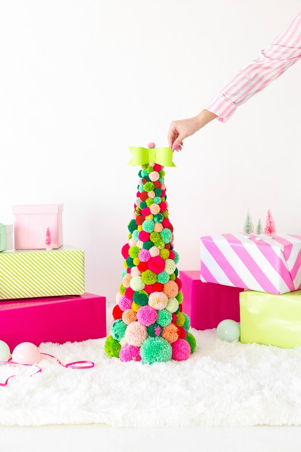 Pom Pom Christmas tree - colorful and whimsical  holiday decor by Awwsam. #christmastree #pompoms #holidayDIY