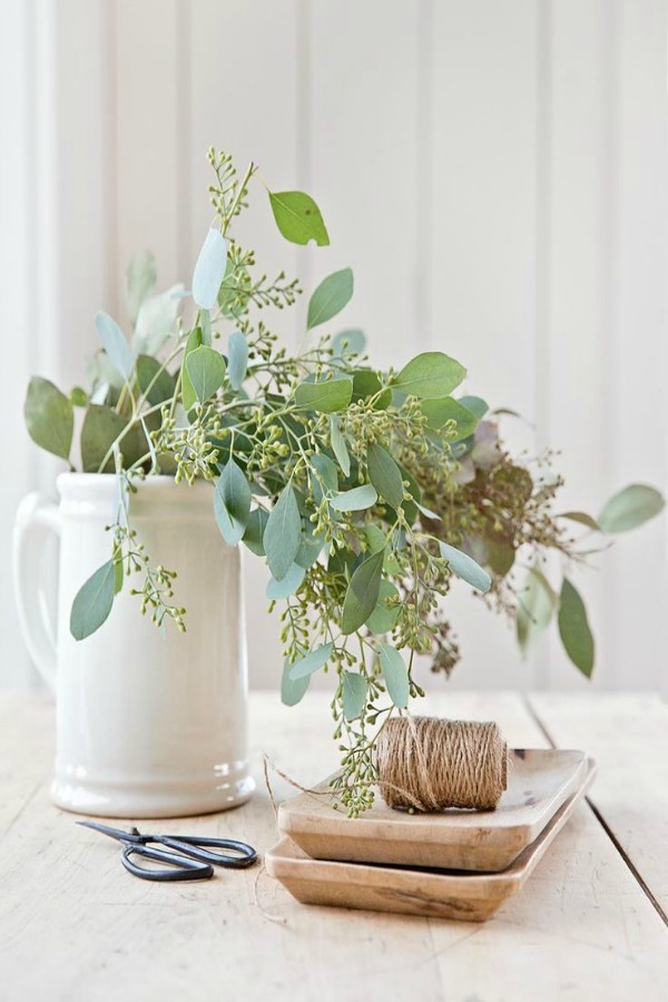 Do you love the simpler side of fall decor like this fresh eucalyptus in a white pitcher - styling by A Rosy Note? Serene French Farmhouse Fall Decor Photos ahead! #falldecor #fallfarmhouse #serenedecor #eucalyptus #centerpiece