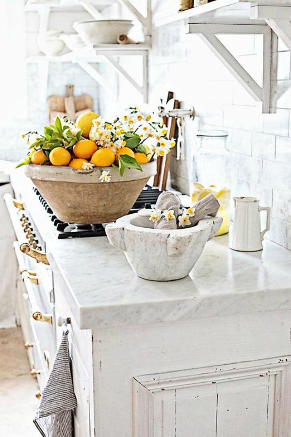 White French farmhouse kitchen with marble counters and French range.Dreamy Whites Atelier. #frenchfarmhouse #decorating #interiordesign #whitedecor #dreamywhites #whitefarmhouse