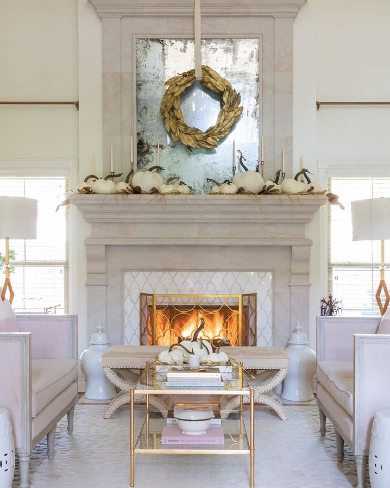 Serene white pumpkin fall decor in a traditional living room with cozy fireplace - Jennifer Maune. #falldecor #autumndecor #serenedecor #interiordesign #fireplace