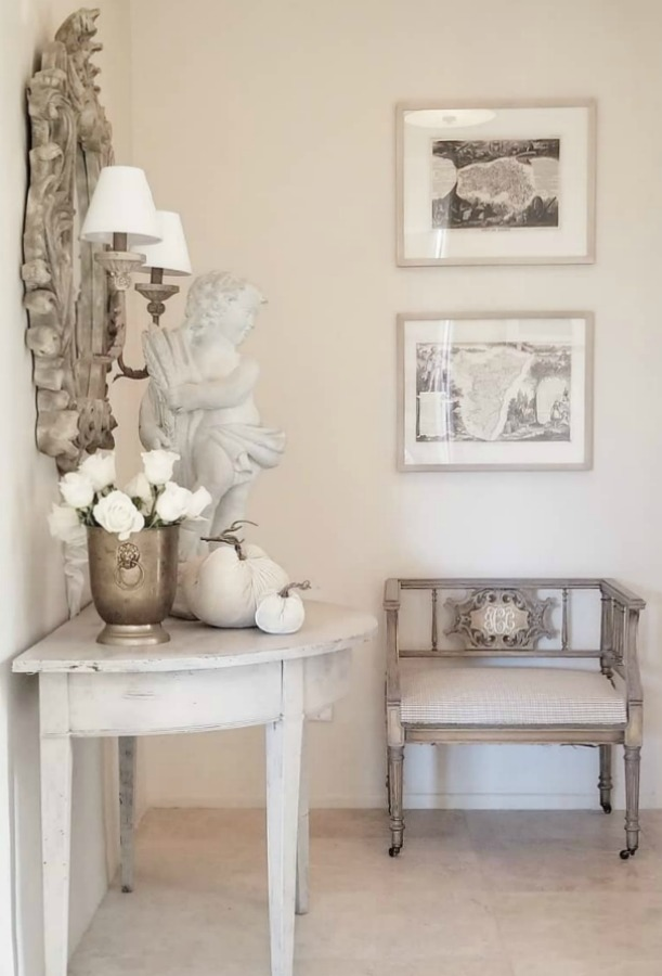 Elegant French country furnishings, white pumpkins, and white roses - interior design by The French Nest Co. #frenchcountry #interiordesign #toneontone #whitepumpkins