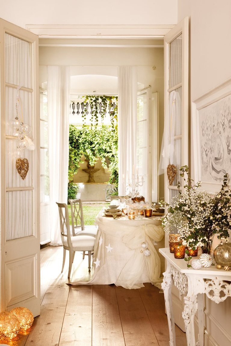 A beautifully restored 1864 home on the Maresme Coast of Spain is decorated in whites for Christmas. #christmasdecor #housetour #whitechristmas #romanticchristmas #frenchcountry #frenchchristmas #whitedecor