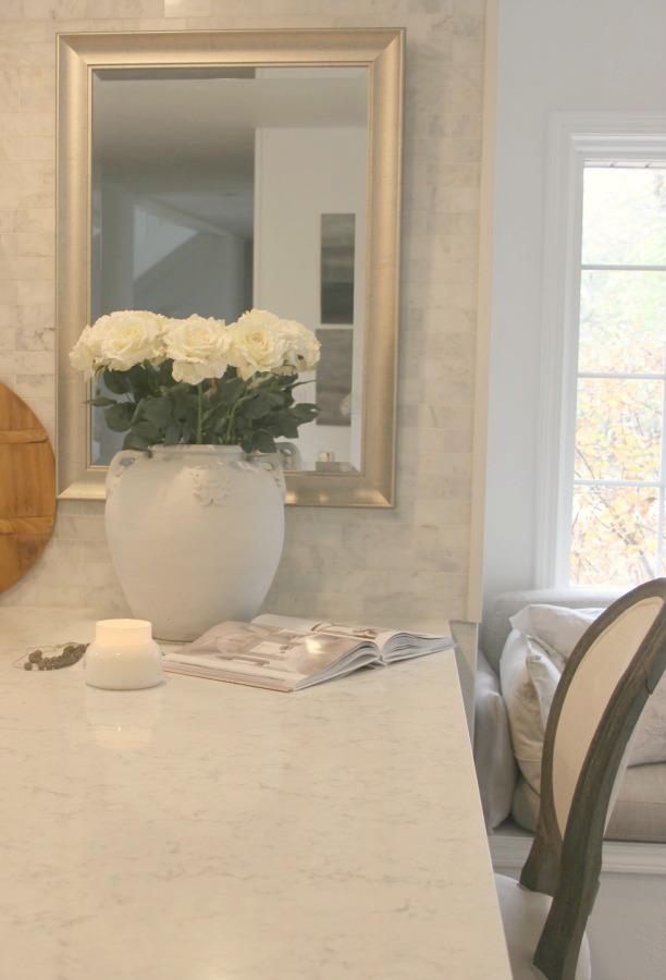 My white kitchen with Viatera Minuet quartz countertops and marble subway tile backsplash - Hello Lovely Studio. #minuet #viateraquartz