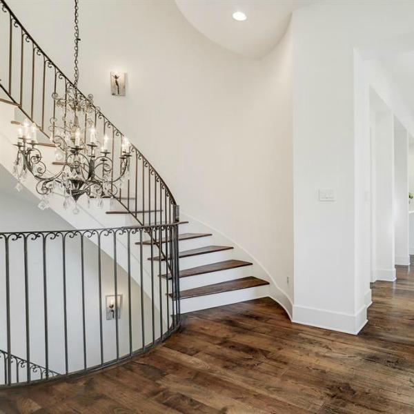 Gorgeous modern European country design style in this Houston home by Southampton. #europeancountry #interiordesign #whitedecor #modernfrench #staircase