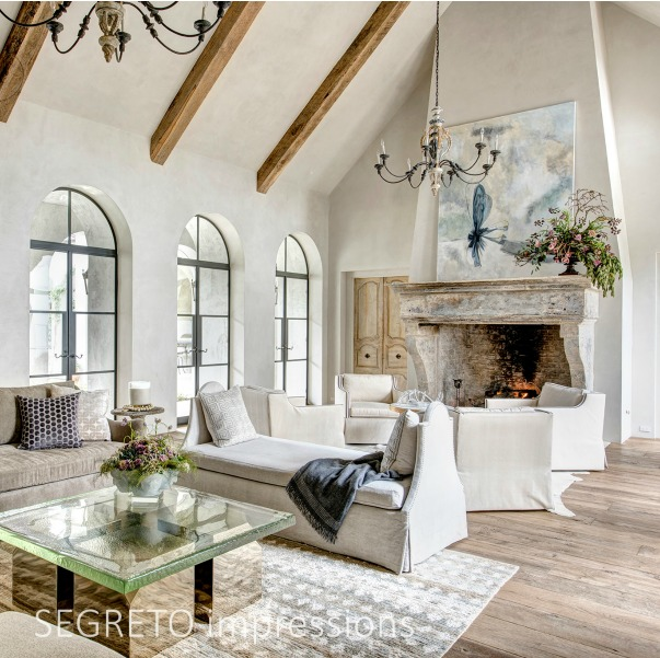 From SEGRETO impressions (2019) by Leslie Sinclair. This great room incorporates beams from the homeowner's South Texas ranch as well as 18th-century doors from Avignon. #interiordesign #frenchcountry #plasterwalls #greatroom