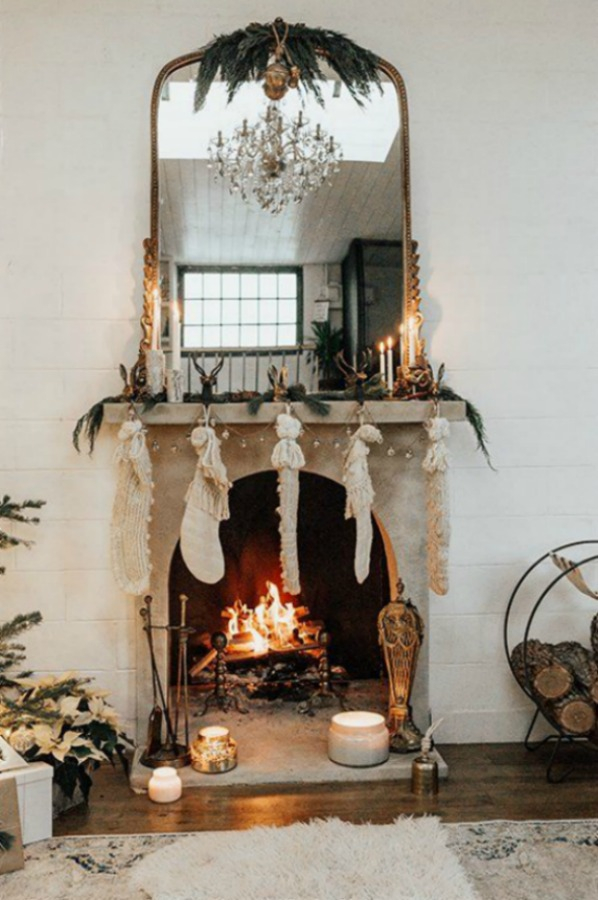 Beautiful and romantic holiday decorated fireplace - Anthropologie. #holidaydecor #fireplace #christmasdecor