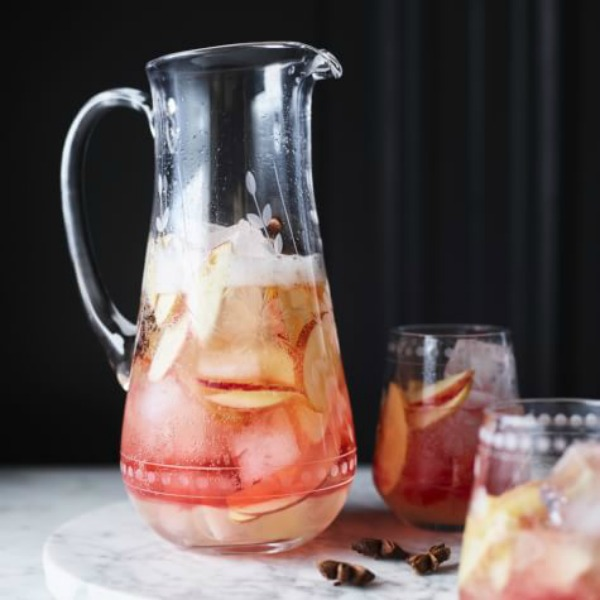 Apple cider cocktail in clear glass pitcher - Williams Sonoma. #applecocktail #cocktails #applecider