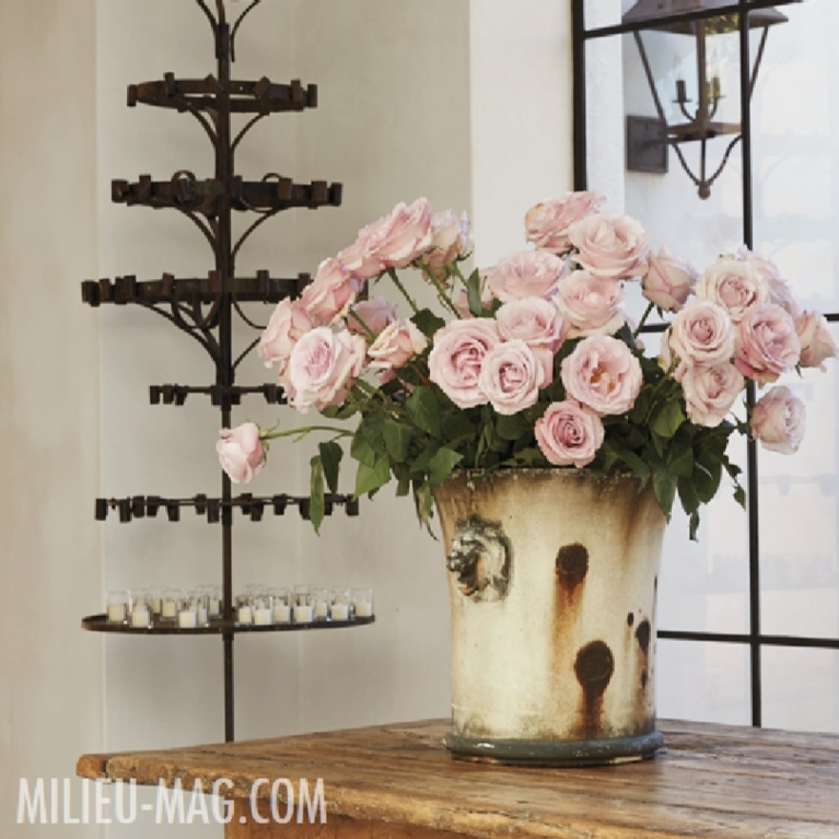 Blush pink roses in an Old World style planter in a French country home with design by Pamela Pierce - Milieu magazine.