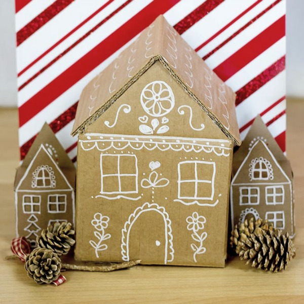 Cardboard diy gingerbread gift box is a simple project requiring a box, glue, and a white chalk pen! #cardboardboxcraft #christmasdiy #gingerbreadhouse