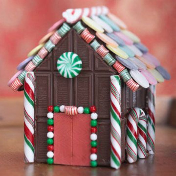 Hershey's chocolate decorated candy house - BHG. #gingerbreadhouse #candyhouse #christmasdiy #christmassweets