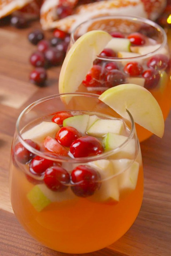 Delicious cocktail or mocktail idea for Thanksgiving with apples and cranberries - sangria recipe from Delish. #sangria #thanksgivingrecipes #thanksgivingmenu #applecranberry